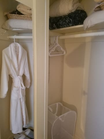 Closet available with spare blankets and a fluffy robe and slippers