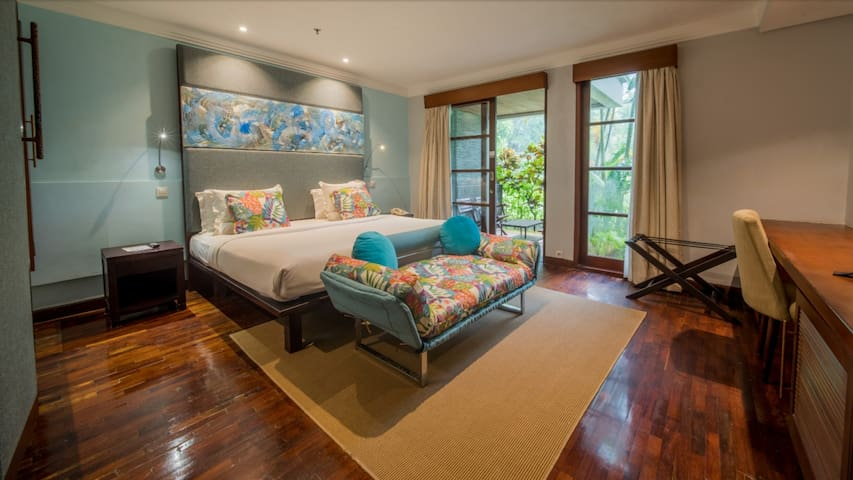 This master bed room has a view to the main garden.