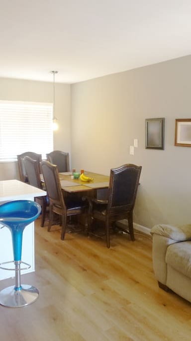 Cozy dining room with custom African mahogany hardwood dining table and leather dining chairs.
