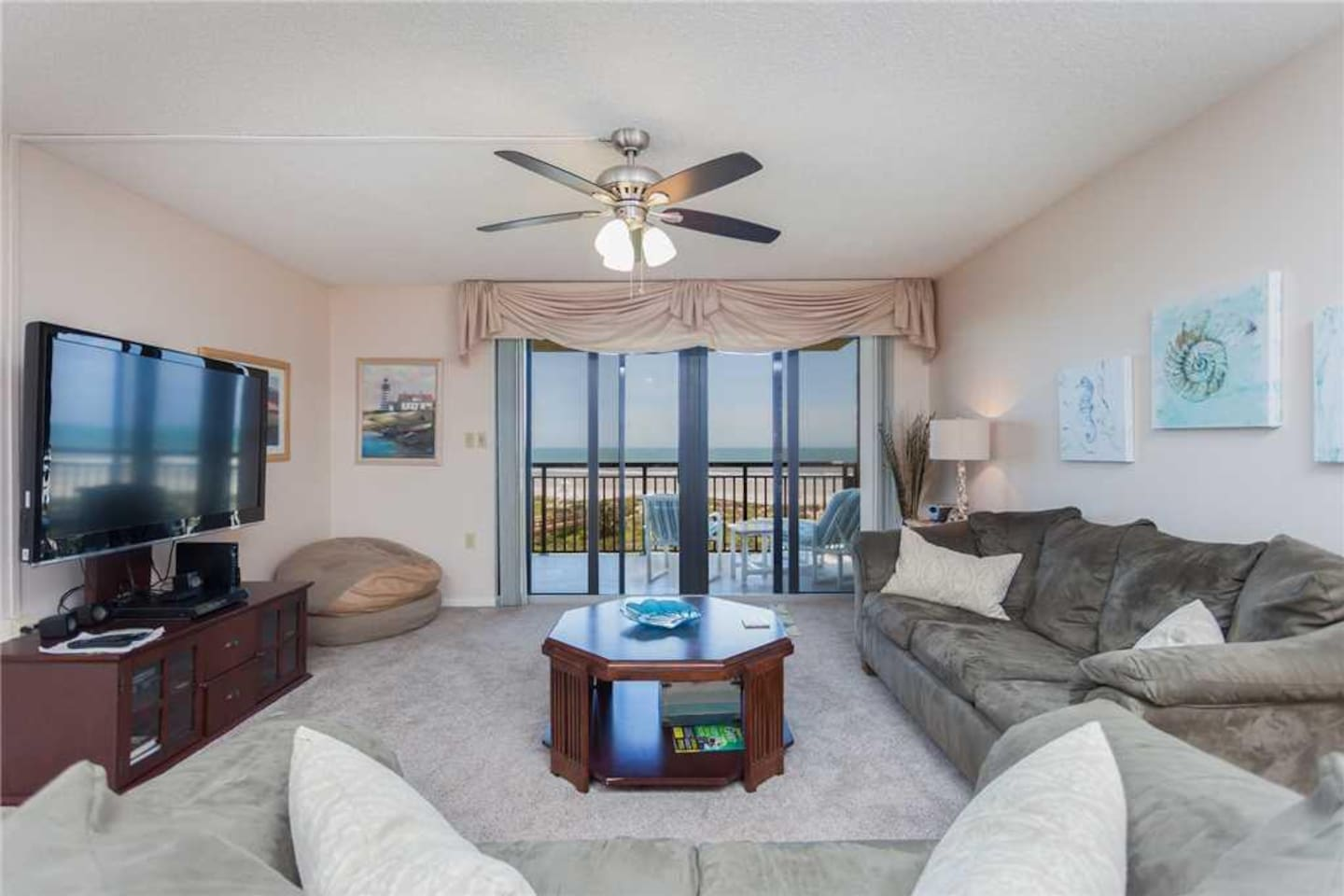 Welcome to Barefoot Trace 315! - The living room provides quick and easy access to the balcony where you can sit and enjoy the co