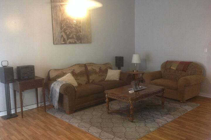 Cozy living room, shared space with a TV, DVD, movie library and radio tuned to local channels.