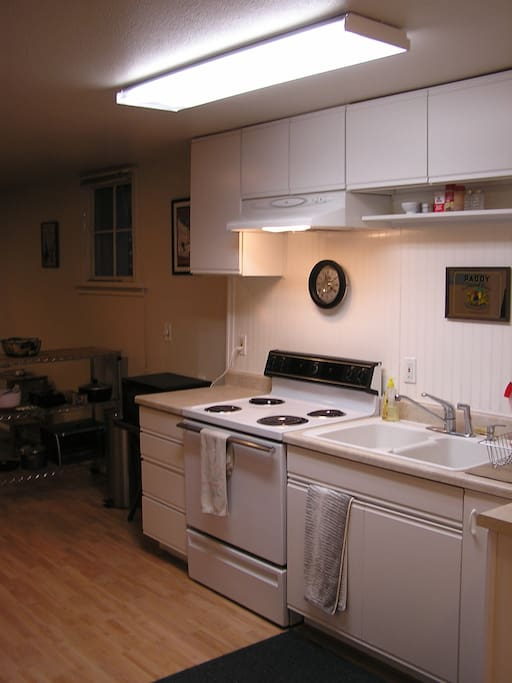 Kitchen, including microwave, toaster oven, coffee maker.