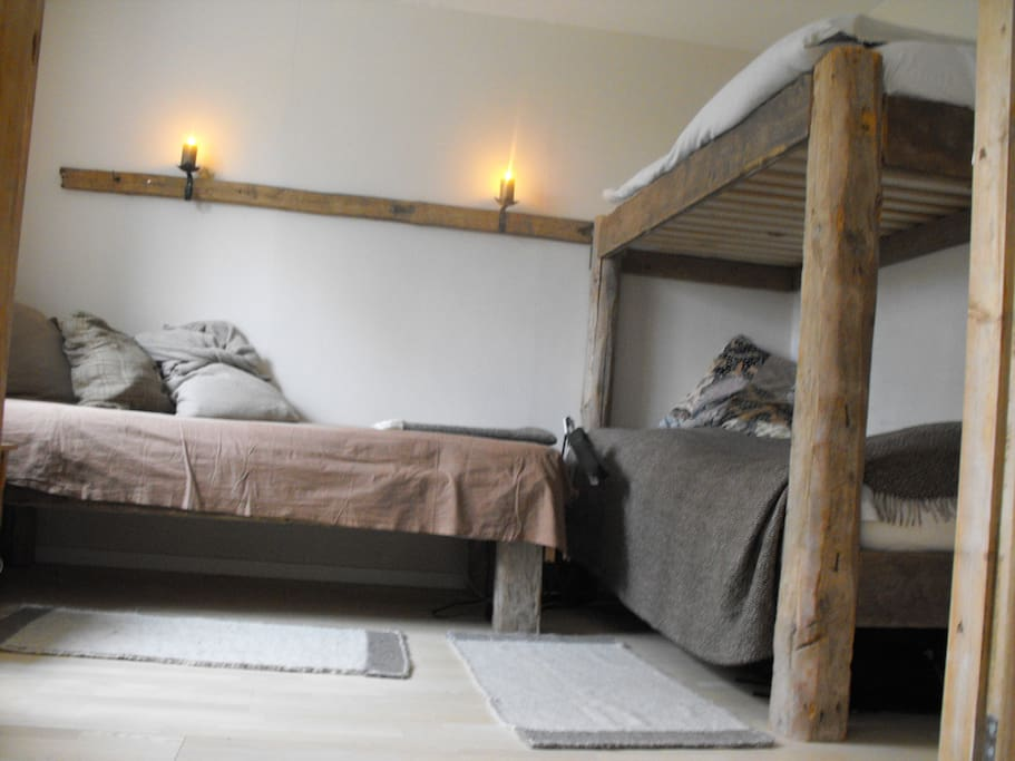 One bedroom with 3 beds. The 2 low beds can become a doble bed