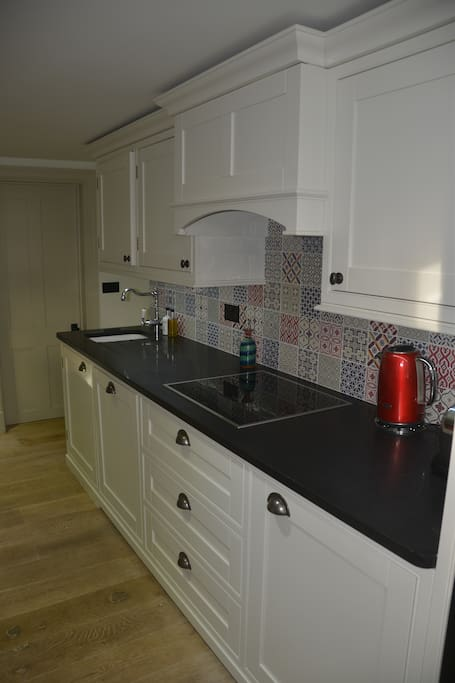 Fully Equipped Kitchen with oven, Microwave, fridge, crockery, cutlery and everything you may need.
