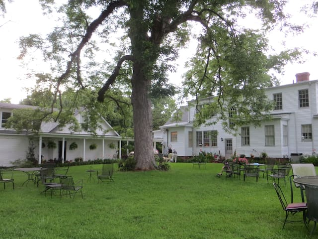South lawn view of Guest House (left) and Main House (right)