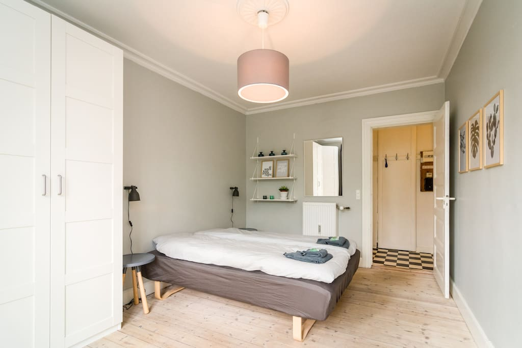 Bedroom with double bed and french balcony.