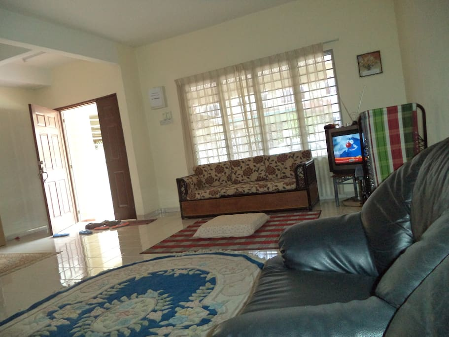 The living room is very spacious. You can watch TV or chit chat all day long.