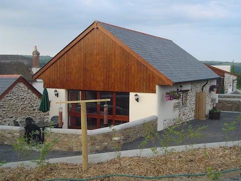 Converted barn with private hot tub in North Devon