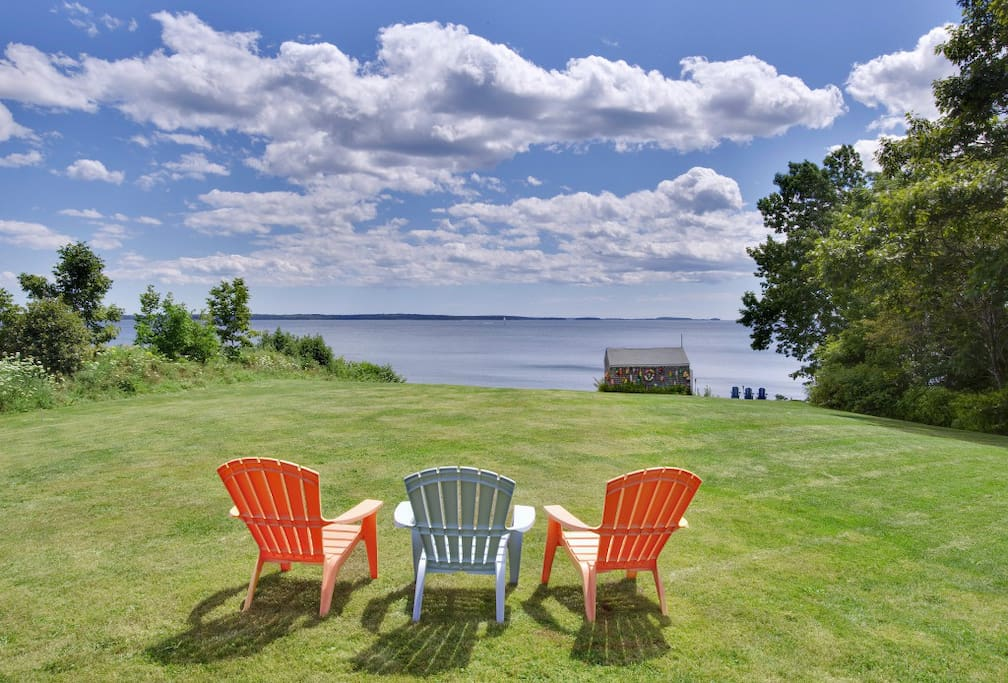 Sweeping lawn with panoramic water views & easy beach access