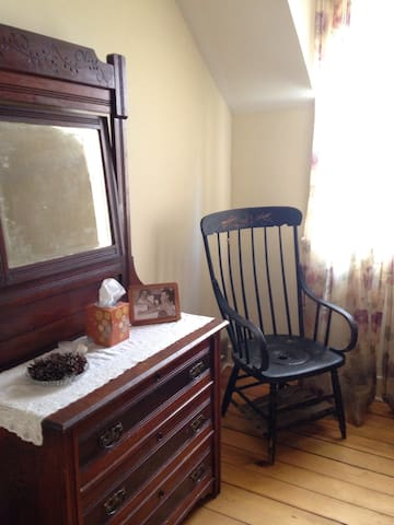 Bedroom #2 with queensize bed and antique furnishings including Moore Homestead commode chair.
