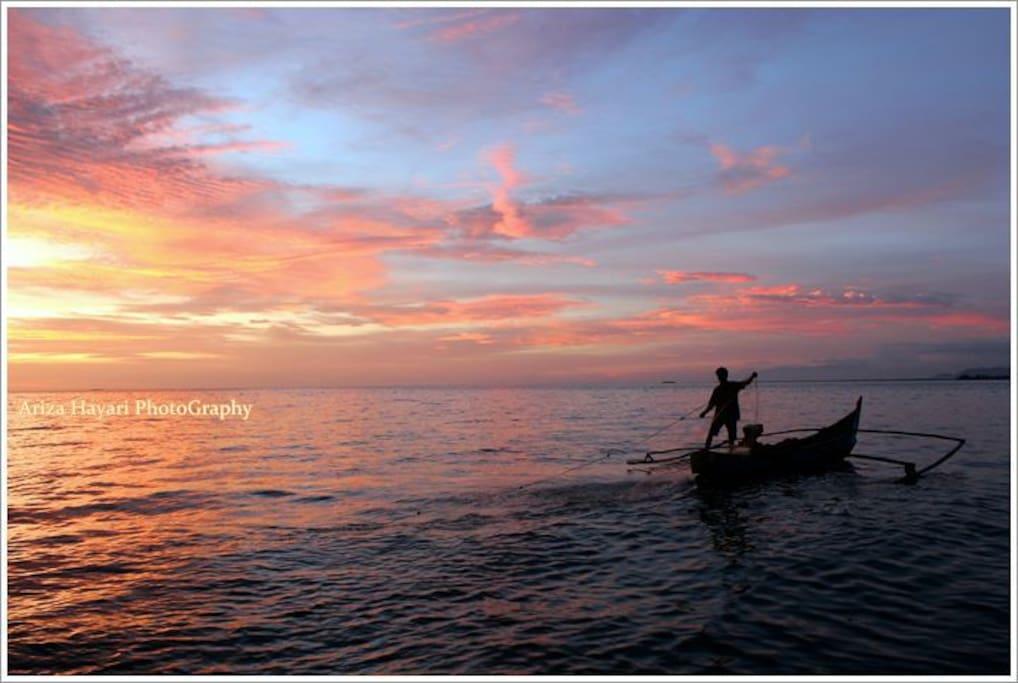 Sunset and the Fisherman ( Pantai Padang )