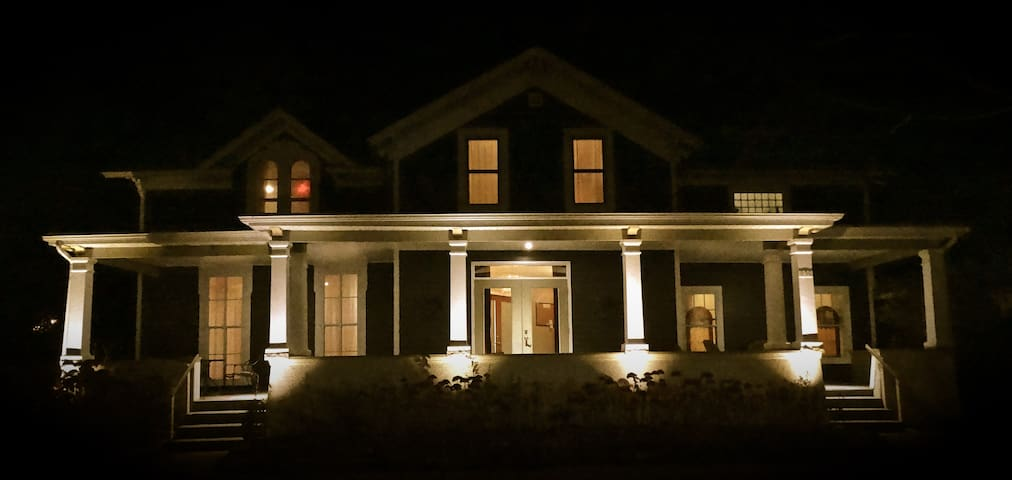Our house at night. Look for the white columns!
