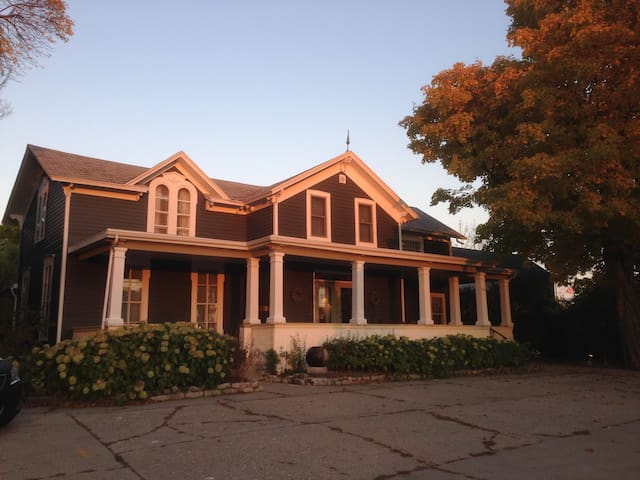Late afternoon sun reflected on our house which was built in 1869.