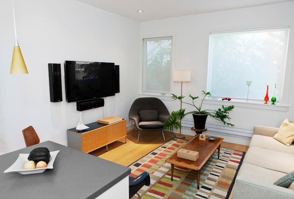 Enjoy large screen HDTV w/ cable,  quality sound system and high speed WIFI