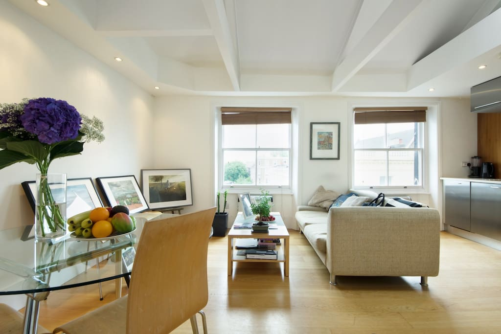 Living room with windows facing Portobello Road, home to the world famous market