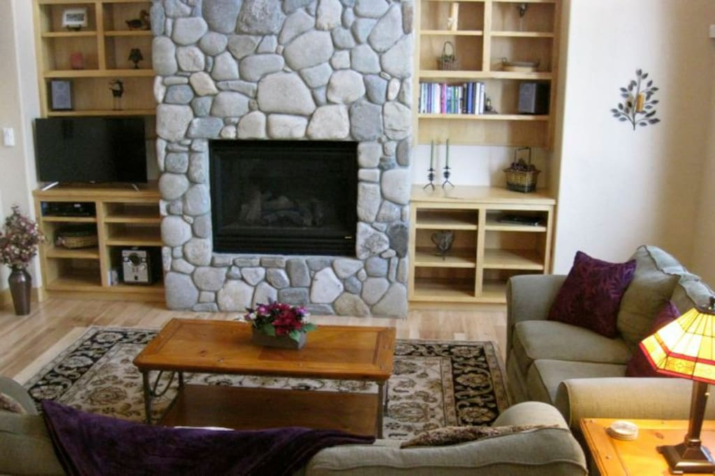 Red Mountain Retreat`s great room with river rock fireplace