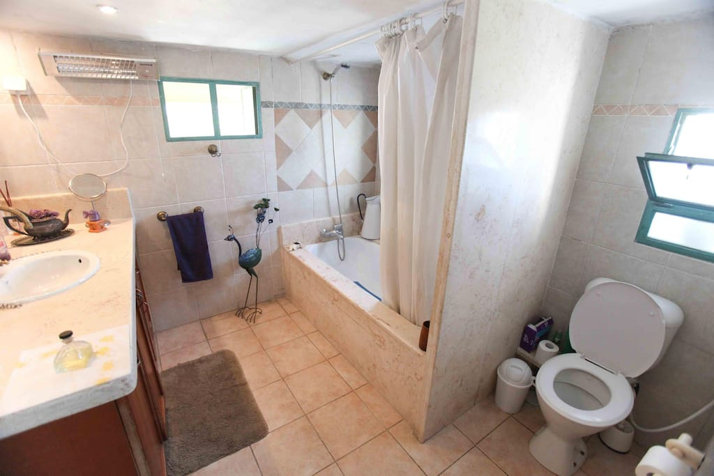 one of the restroom and the bath