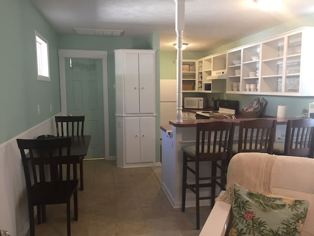 Kitchen is stocked with refrigerator, microwave, dishwasher, coffee maker, stove, toaster, blender and about everything you need to cook a great meal. All you need to bring is the groceries and the cook!