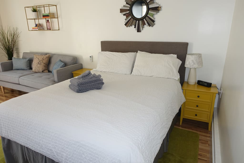 Comfortable queen sized bed with plush mattress