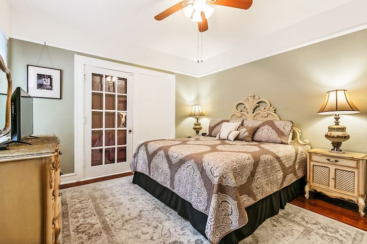 Master bedroom w/ comfortable King size bed and French door that leads to porch