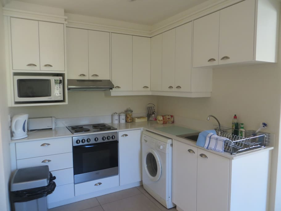 Fully equipped kitchen with washing machine and large fridge/ freezer