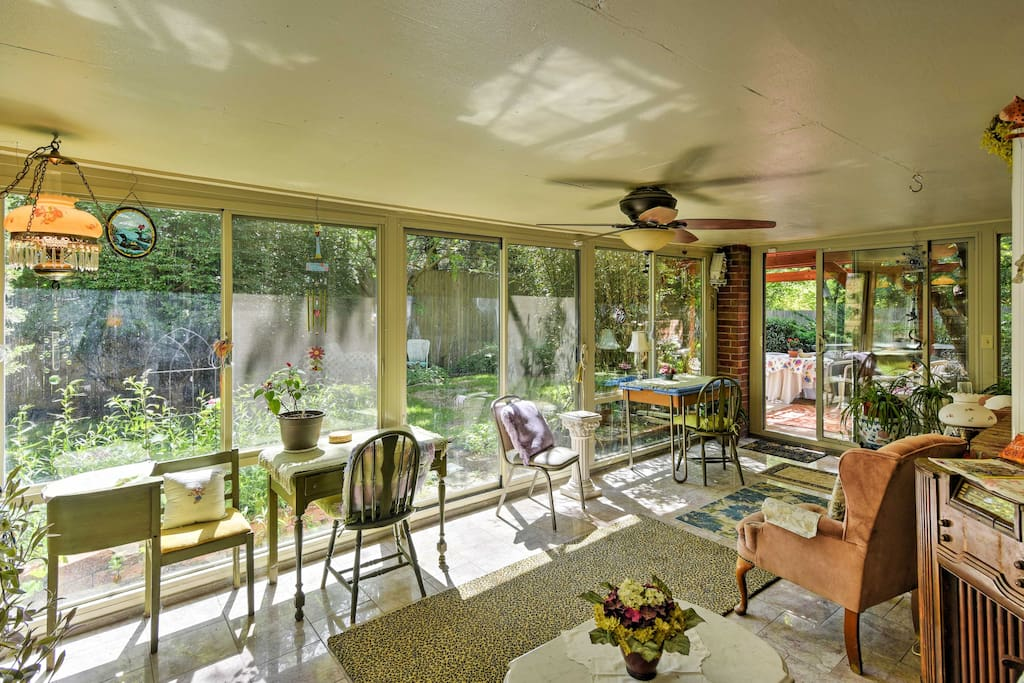 There's no better place to spend sunny mornings than in the comfortable chairs in the sunroom, which overlooks the backyard and garden.