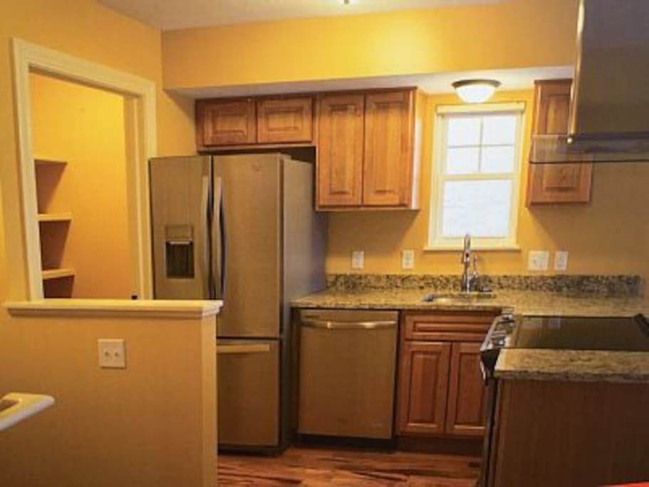 Full Kitchen with pantry that includes and washer and dryer.