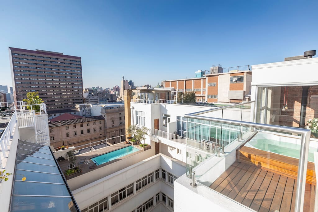 "Private jacuzzi with view of rooftop penthouse swimming pool. ""Hands down the best reservation I have ever made on Airbnb."" - Barbara"