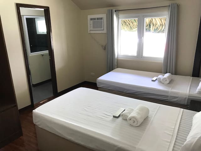 Bedroom #3 has two single beds for 2 occupants. The beds can be joined side by side to form a king-size bed for a couple. It has an ensuite bathroom with hot/cold shower.