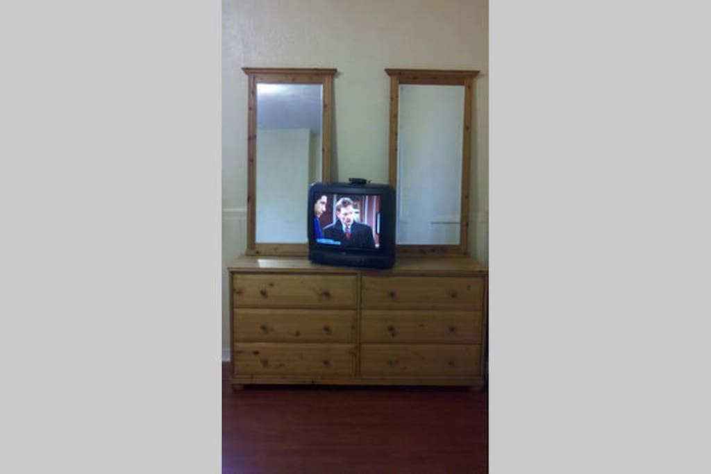 Large dresser with 2 mirrors, and TV with cable