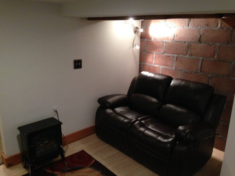 Electric fireplace and reclining loveseat