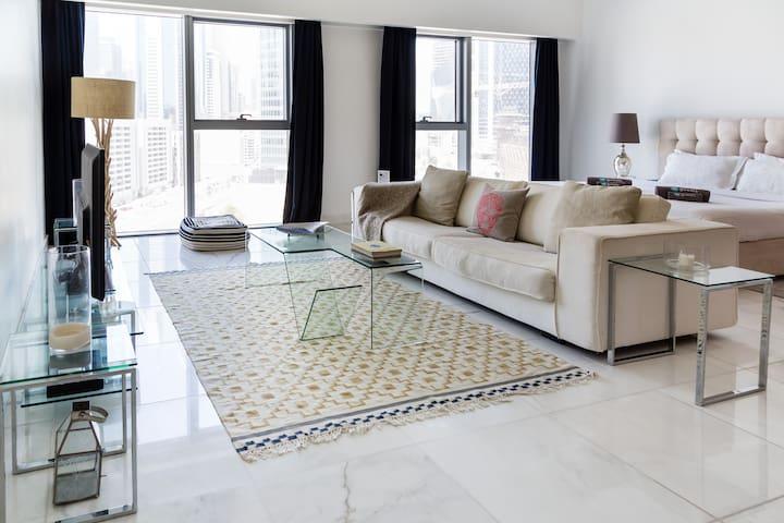 Beautiful living room area with huge sofa