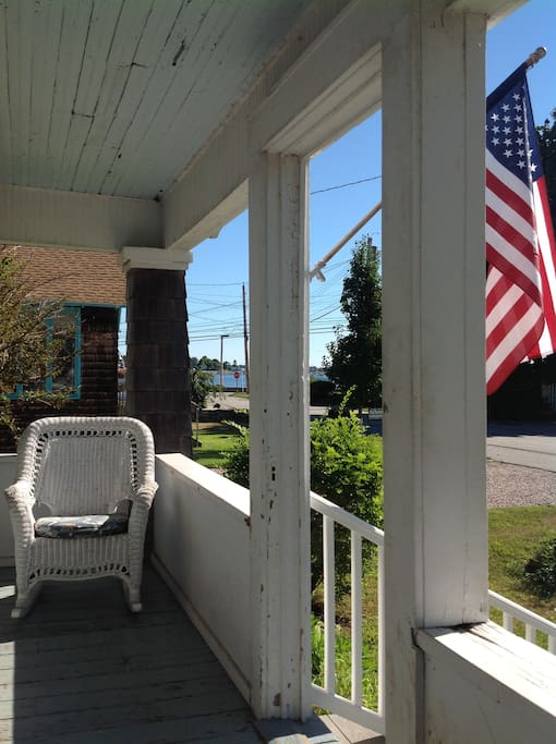 Rocking chairs on the front porch.  Hot outdoor shower on the end.