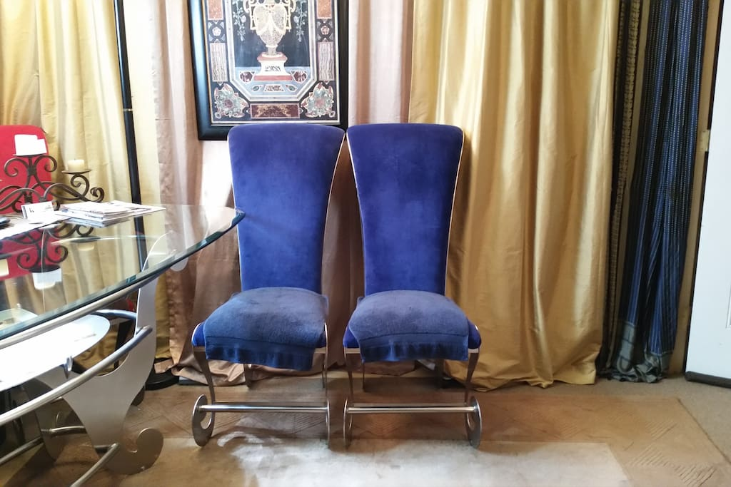 Blue Velvet chairs. vacuum & heater hide behind the curtain