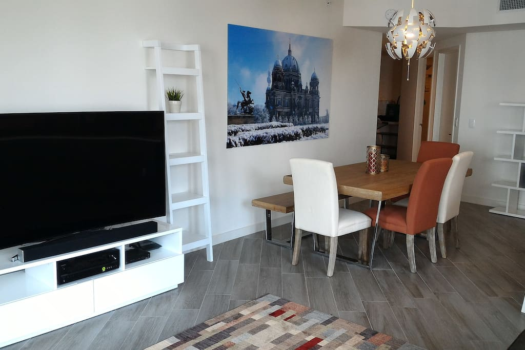 View of dining table & TV