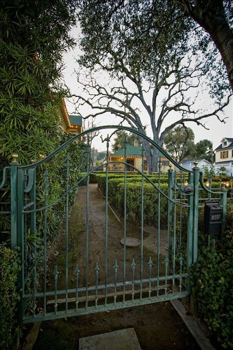 Front gate that leads from the street through the English boxwood garden to the Carriage House.