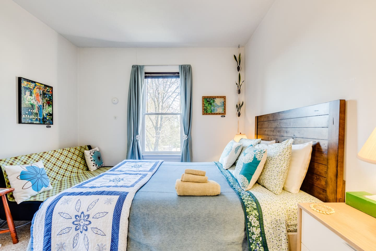 Restful, comfortable, clean bedroom. Queen-sized mattress, air conditioner during warm months, the best blackout curtains on the market, high-quality pillows, futon, work desk and large closet with hangers.