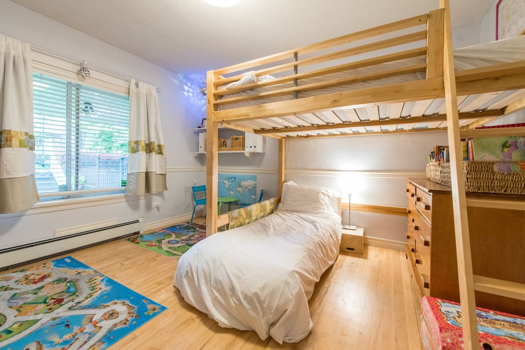 Children's bedroom off the main living space with a double loft bed (can sleep two adults) and a toddler bed.