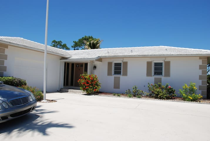 Home close to beaches, 2BR, sunroom,  large pool!