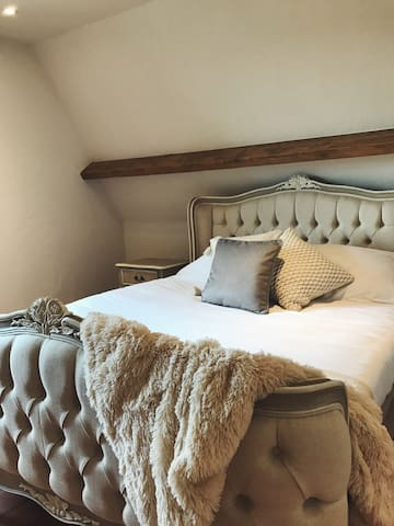 Master bedroom - with luxury roll top bath and shared en-suite