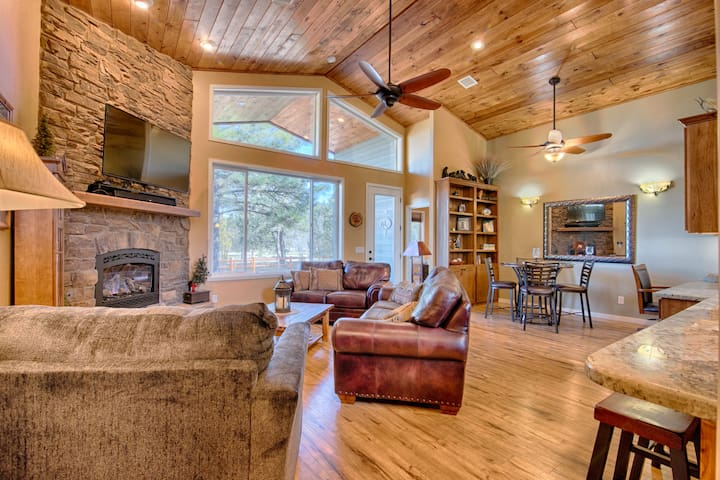Living Room with beautiful high ceilings and gas fireplace as seen from the Entrance