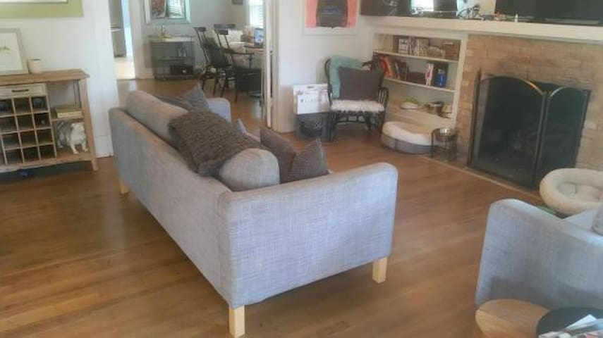 Living room w/ 60 inch HD TV
