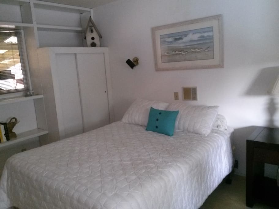 Queen bed in the Main Bedroom, twin bed on the fully enclosed sleeping porch.