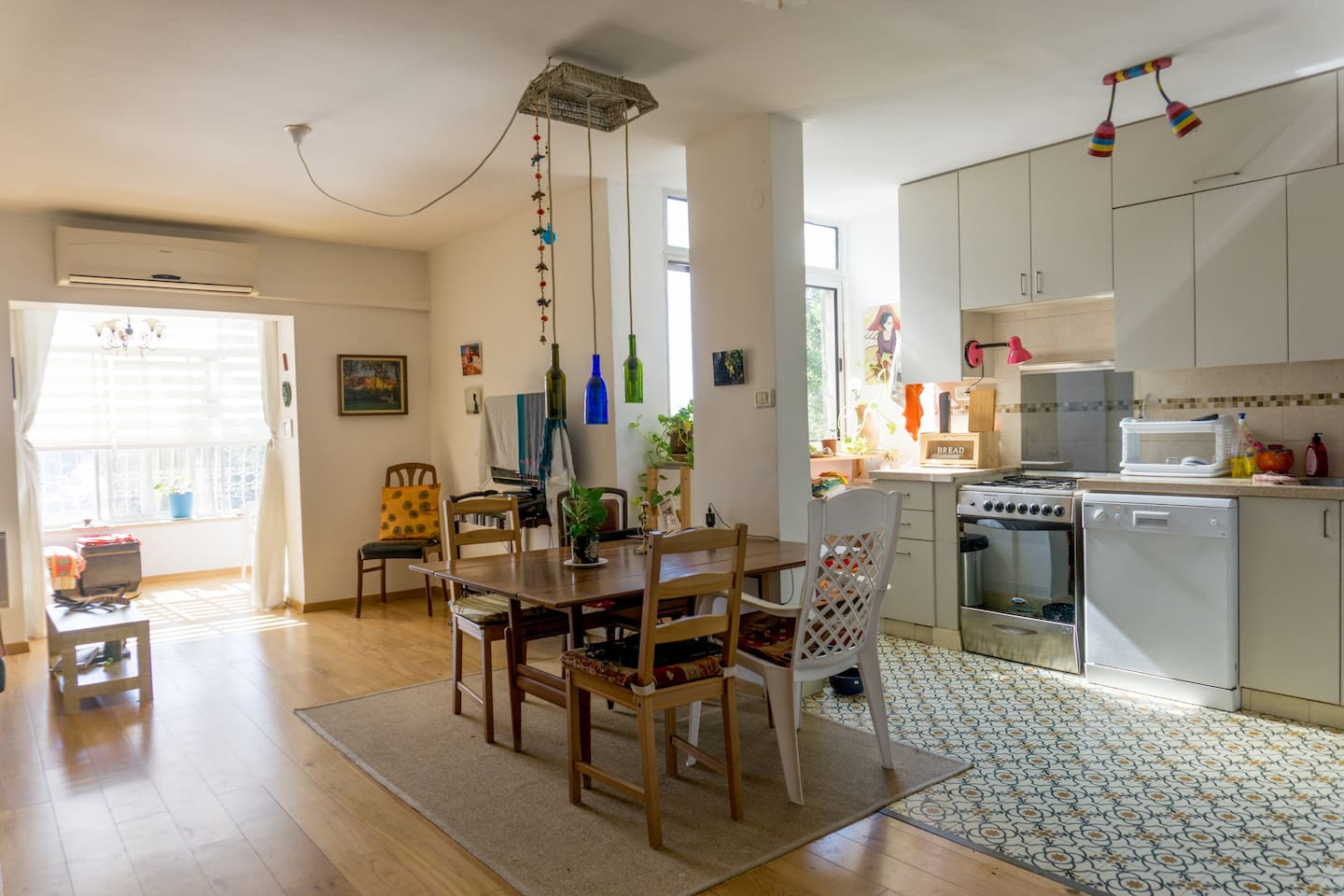 Living, dining and kitchen area, with sunny enclosed balcony.