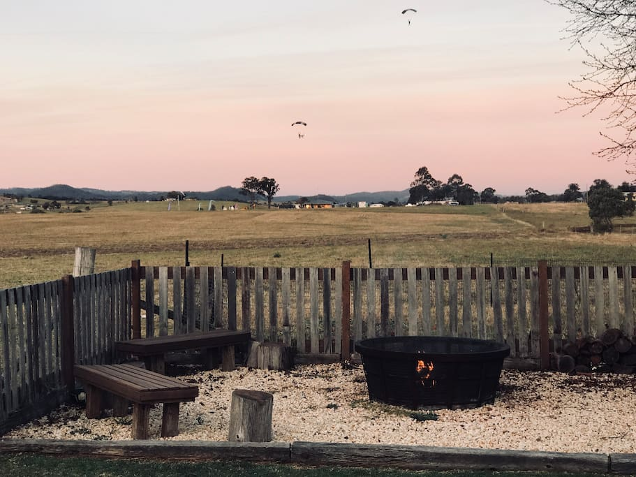Watch the parachutists land whilst toasting marsh mellows by the fire pit.