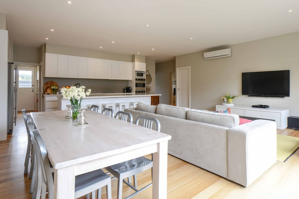 Open Plan living space and a new 65inch TV with Foxtel and net flicks. 10 seat dining table opens out to a great light filled court yard.