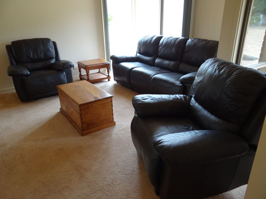 Real leather lounge suite with recliners.