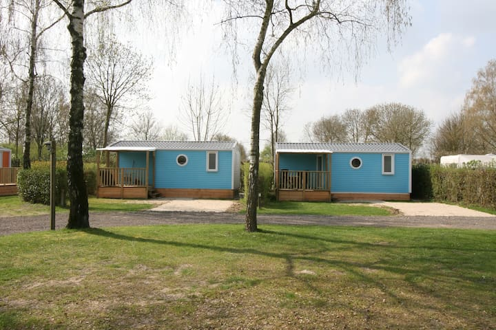 Blue veranda mobile home in the Betuwe