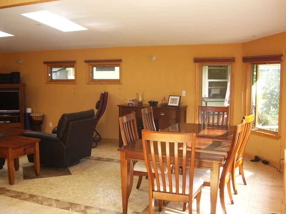 Large open shared room with the living room, kitchen, and dining area