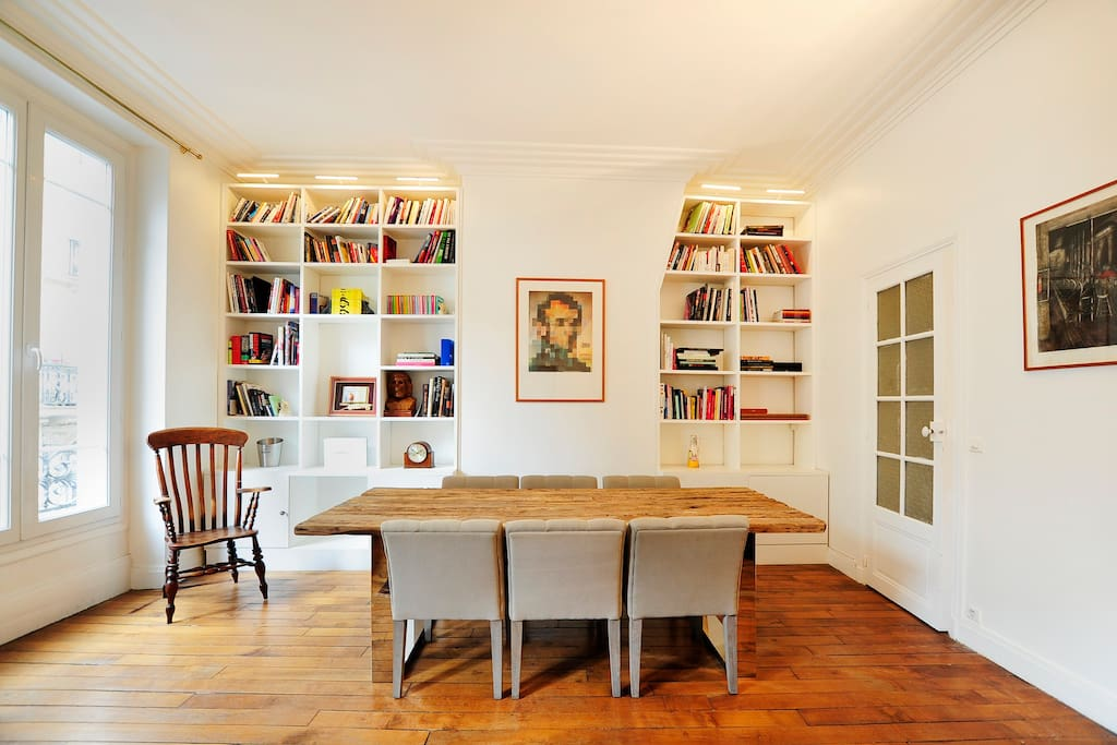 Dining area can host 8 guest comfortably. The bookshelf is full of interesting books